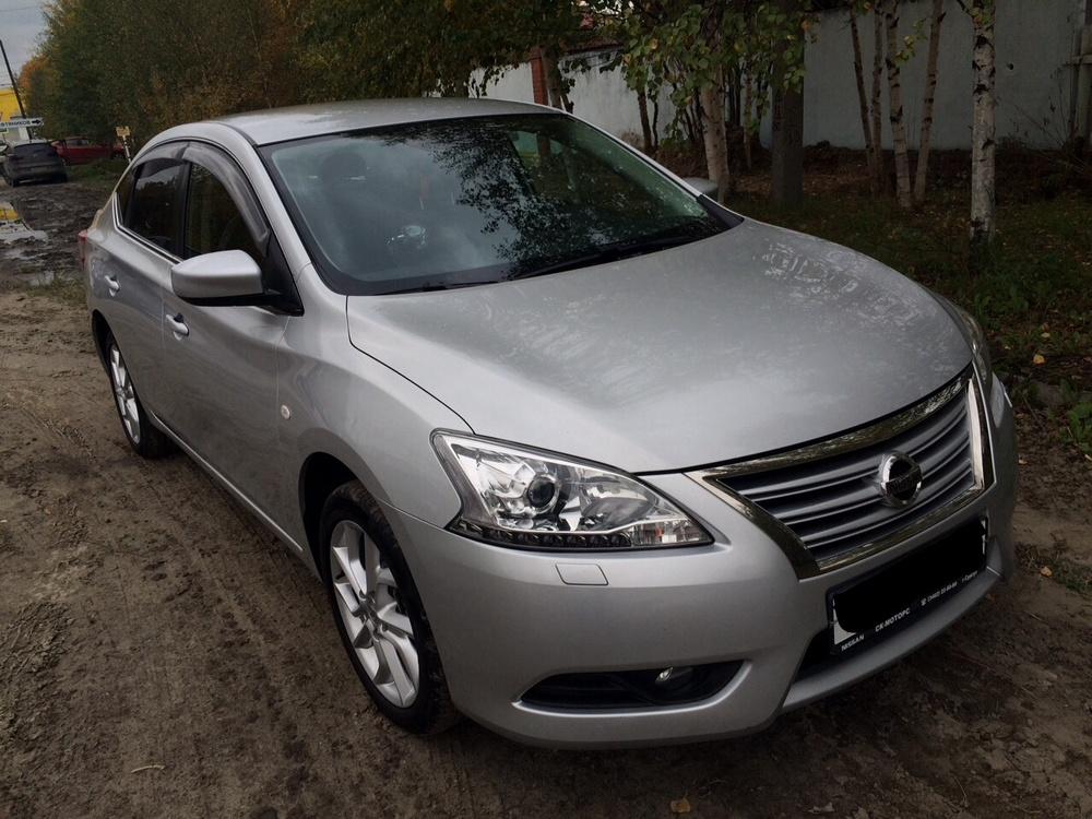 Подержанный Nissan Sentra, отличное состояние, серебряный , 2014 года выпуска, цена 900 000 руб. в ао. Ханты-Мансийском Автономном округе - Югре