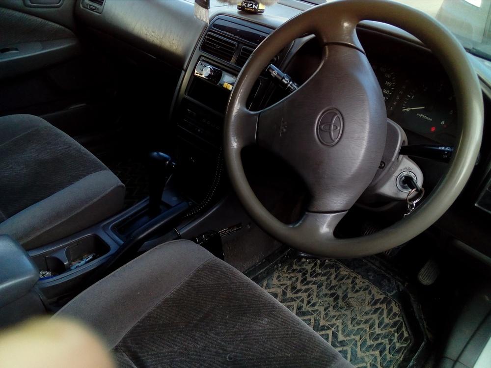 Подержанный Toyota Corona, хорошее состояние, серый металлик, 2001 года выпуска, цена 210 000 руб. в ао. Ханты-Мансийском Автономном округе - Югре