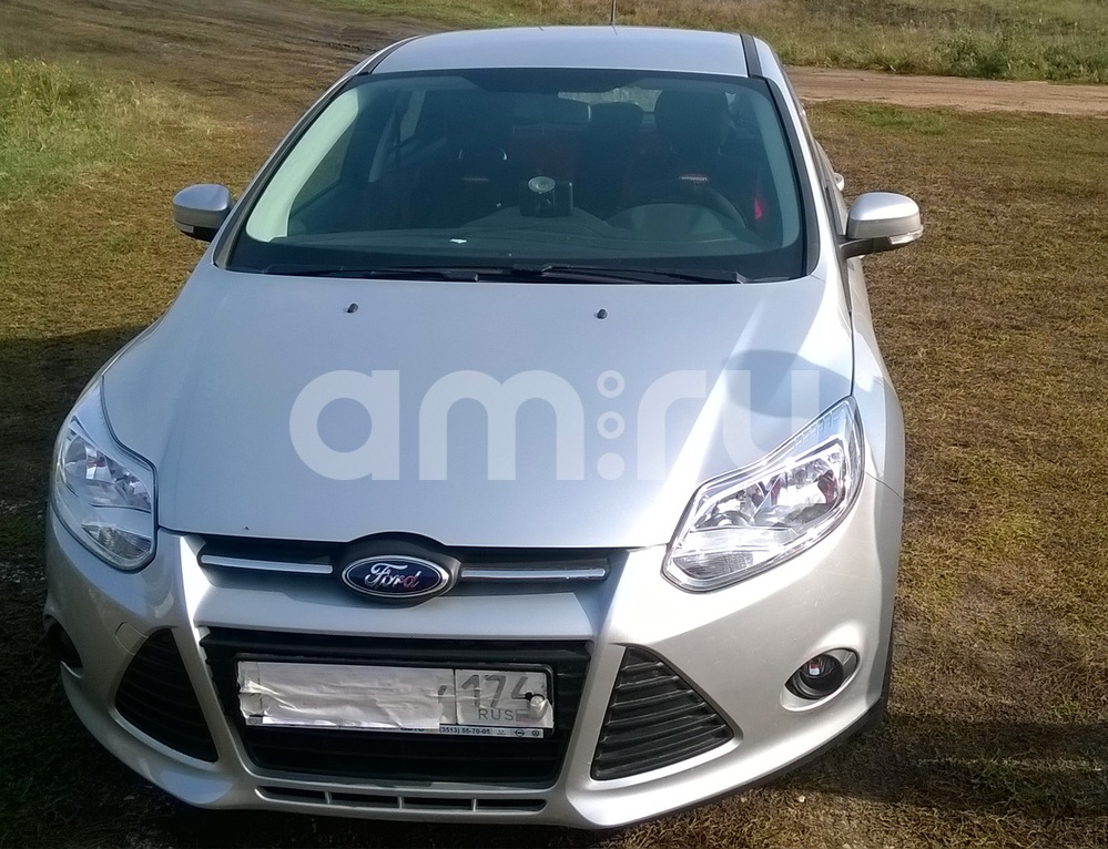 Подержанный Ford Focus, отличное состояние, серебряный , 2014 года выпуска, цена 660 000 руб. в Челябинской области