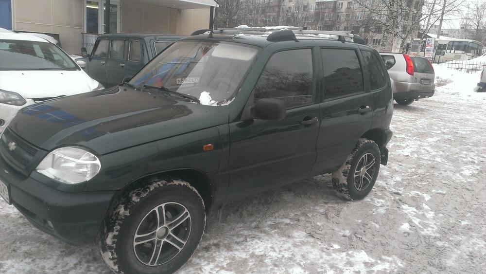 Подержанный Chevrolet Niva, хорошее состояние, зеленый , 2004 года выпуска, цена 140 000 руб. в Архангельске