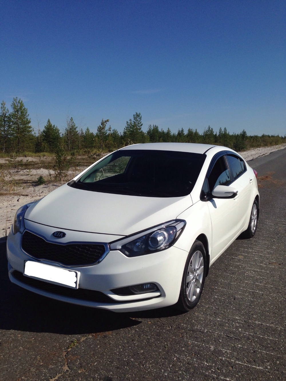 Подержанный Kia Cerato, хорошее состояние, белый , 2014 года выпуска, цена 680 000 руб. в ао. Ханты-Мансийском Автономном округе - Югре