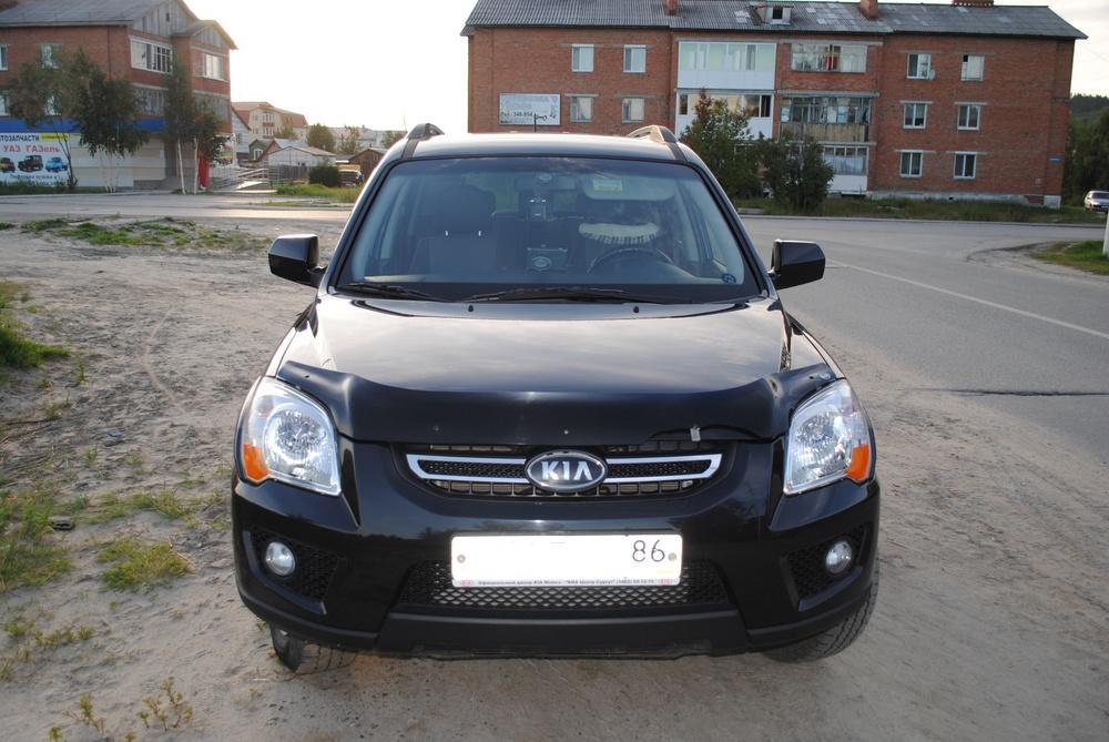 Подержанный Kia Sportage, отличное состояние, черный металлик, 2010 года выпуска, цена 580 000 руб. в ао. Ханты-Мансийском Автономном округе - Югре