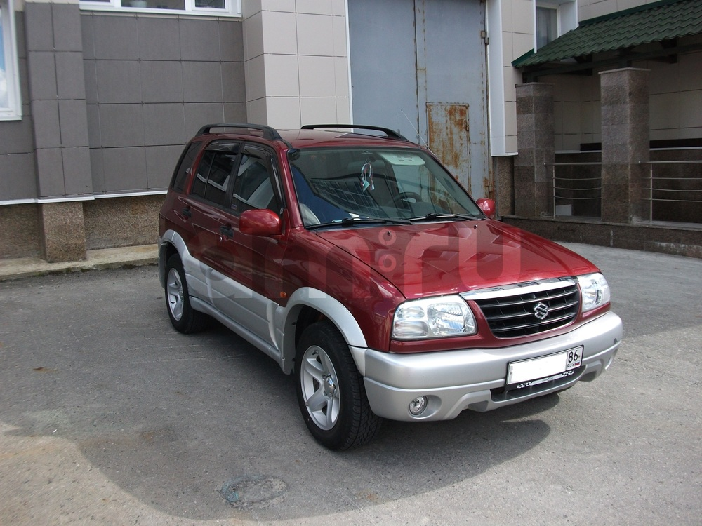 Подержанный Suzuki Grand Vitara, хорошее состояние, бордовый металлик, 2004 года выпуска, цена 450 000 руб. в ао. Ханты-Мансийском Автономном округе - Югре