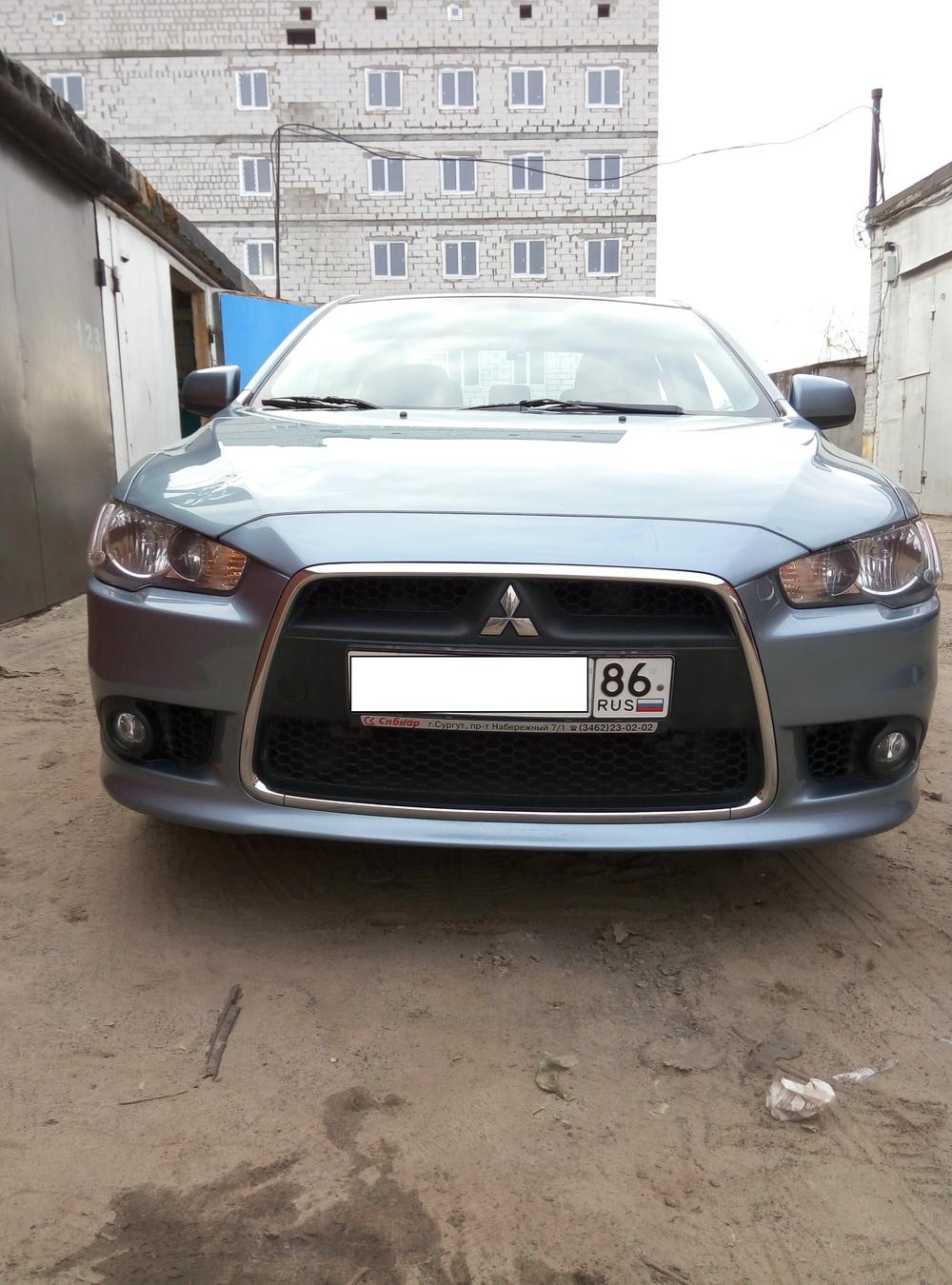 Подержанный Mitsubishi Lancer, хорошее состояние, зеленый металлик, 2011 года выпуска, цена 440 000 руб. в ао. Ханты-Мансийском Автономном округе - Югре