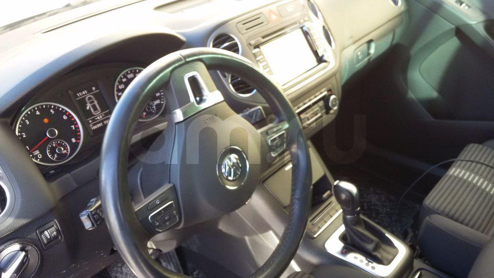 Подержанный Volkswagen Tiguan, отличное состояние, серебряный металлик, 2011 года выпуска, цена 850 000 руб. в Челябинской области