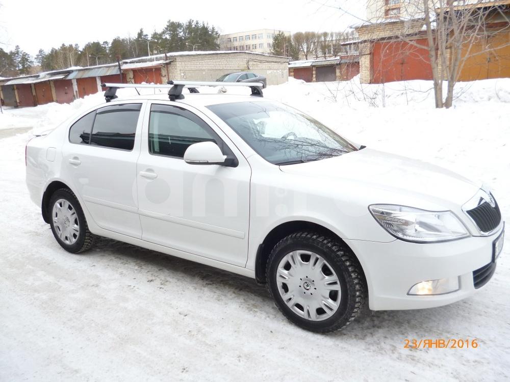Подержанный Skoda Octavia, отличное состояние, белый , 2012 года выпуска, цена 700 000 руб. в Челябинской области