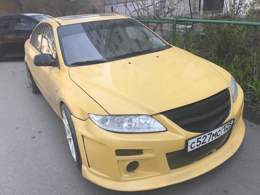 Подержанный Mazda Atenza, хорошее состояние, желтый , 2003 года выпуска, цена 240 000 руб. в Владивостоке