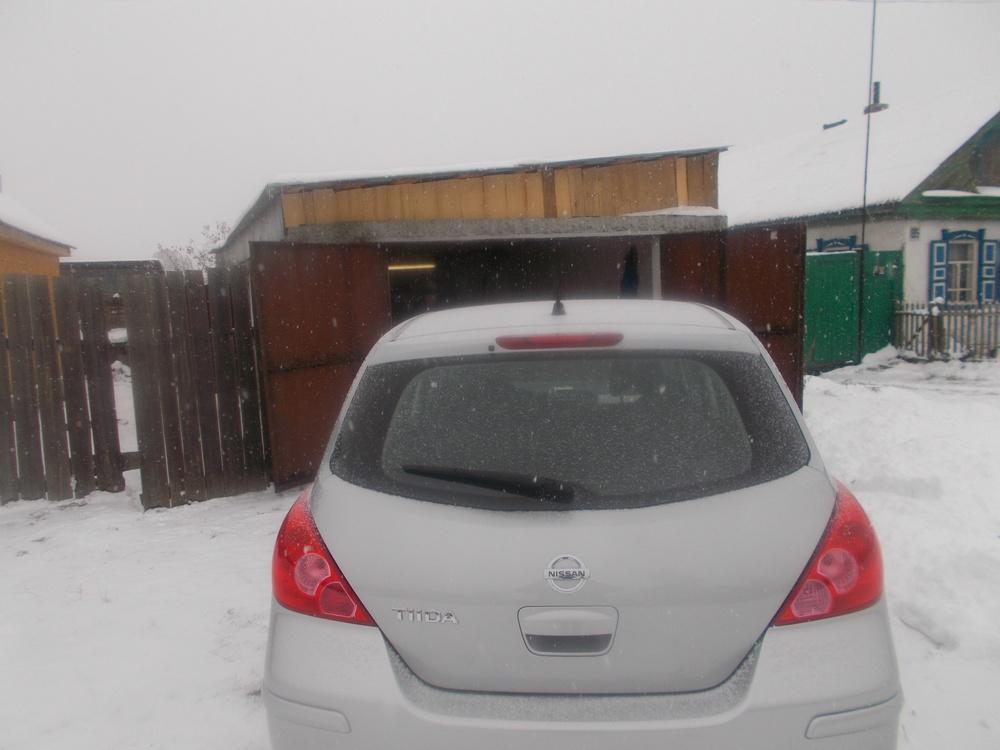 Подержанный Nissan Tiida, отличное состояние, серебряный металлик, 2012 года выпуска, цена 550 000 руб. в Челябинской области