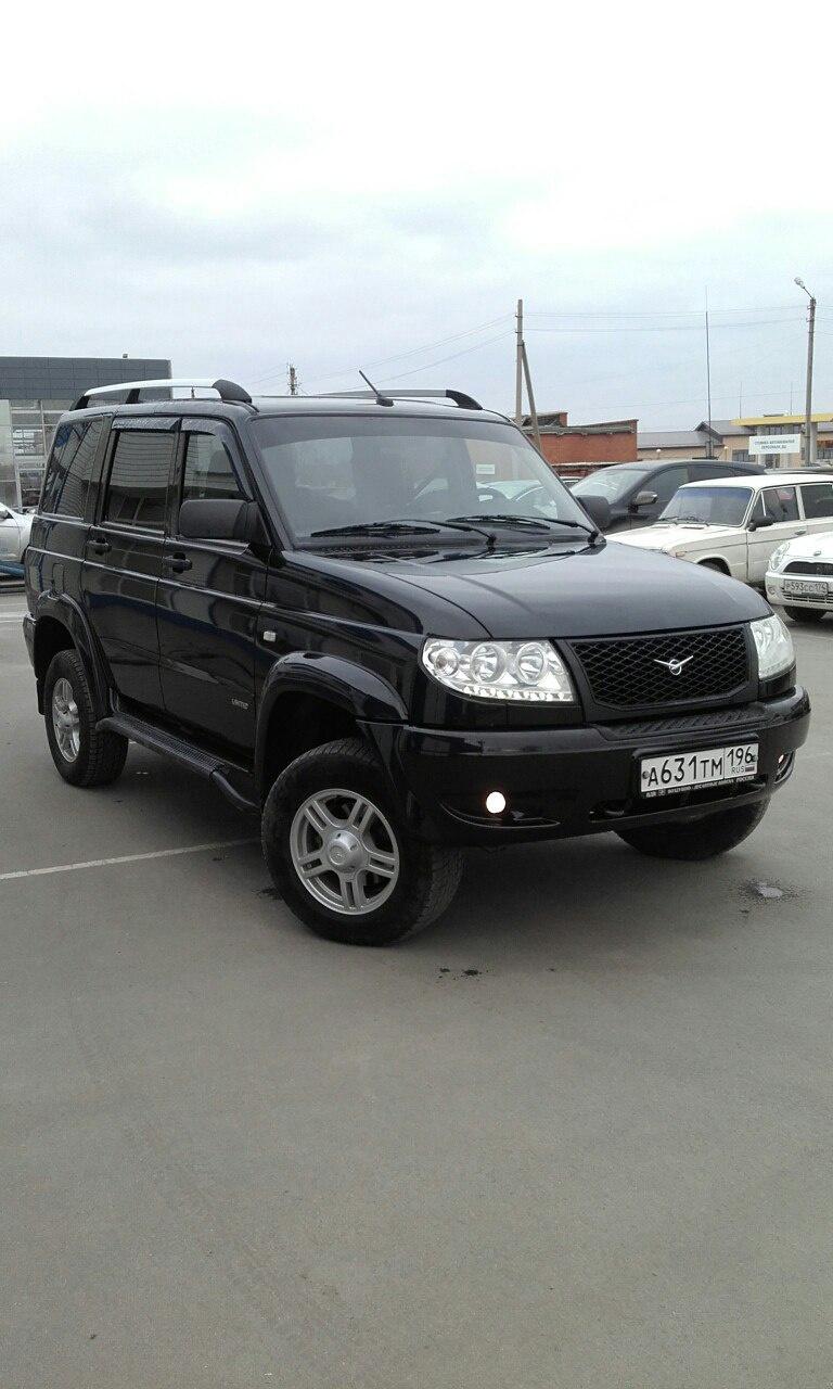 Подержанный УАЗ Patriot, отличное состояние, черный , 2014 года выпуска, цена 640 000 руб. в Челябинской области