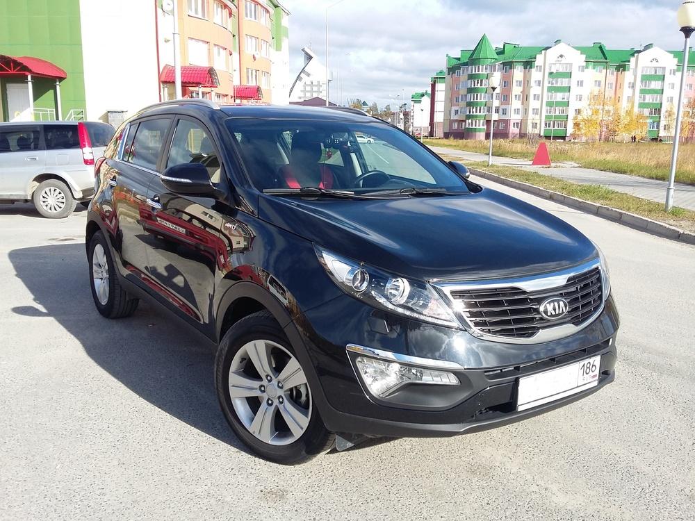 Подержанный Kia Sportage, отличное состояние, черный металлик, 2013 года выпуска, цена 1 100 000 руб. в ао. Ханты-Мансийском Автономном округе - Югре