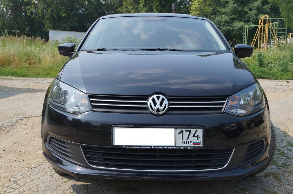 Подержанный Volkswagen Polo, отличное состояние, черный металлик, 2013 года выпуска, цена 470 000 руб. в Челябинской области