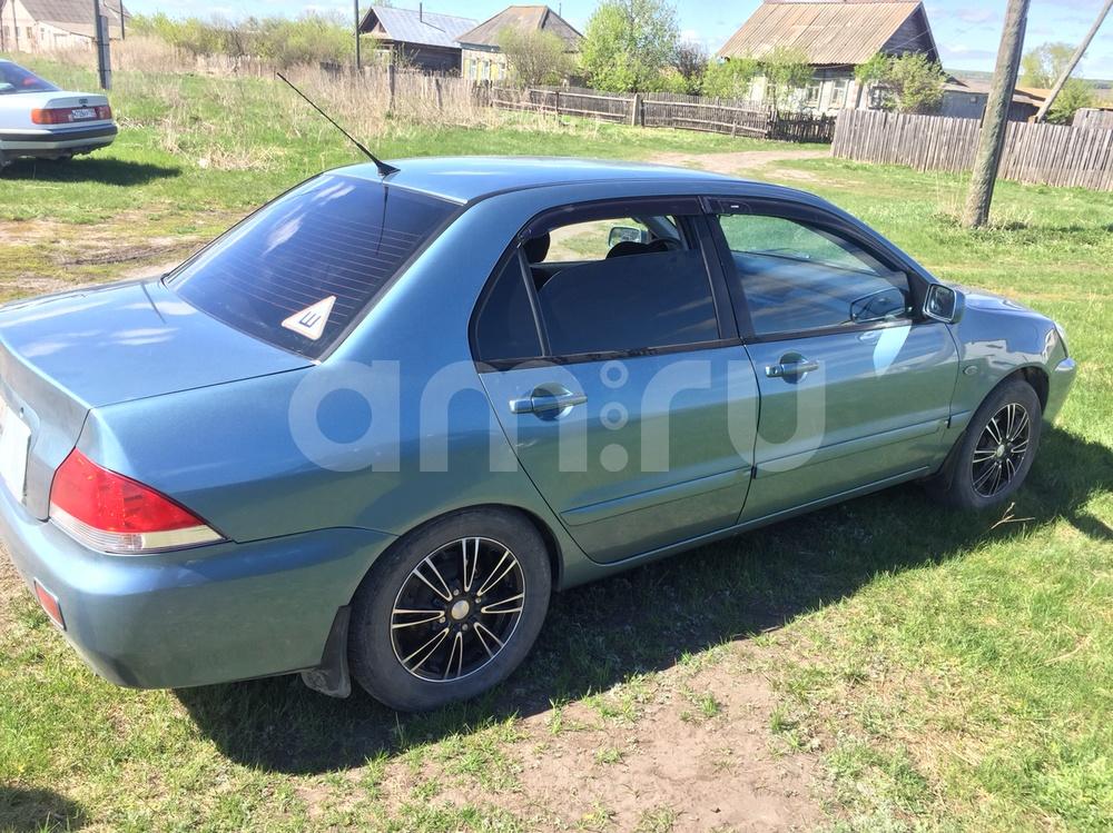 Подержанный Mitsubishi Lancer, хорошее состояние, зеленый , 2005 года выпуска, цена 250 000 руб. в Ульяновской области