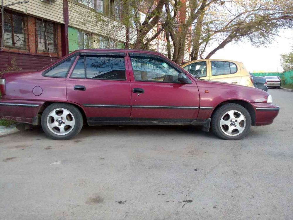 Подержанный Daewoo Nexia, хорошее состояние, бордовый , 2005 года выпуска, цена 95 000 руб. в Тюмени