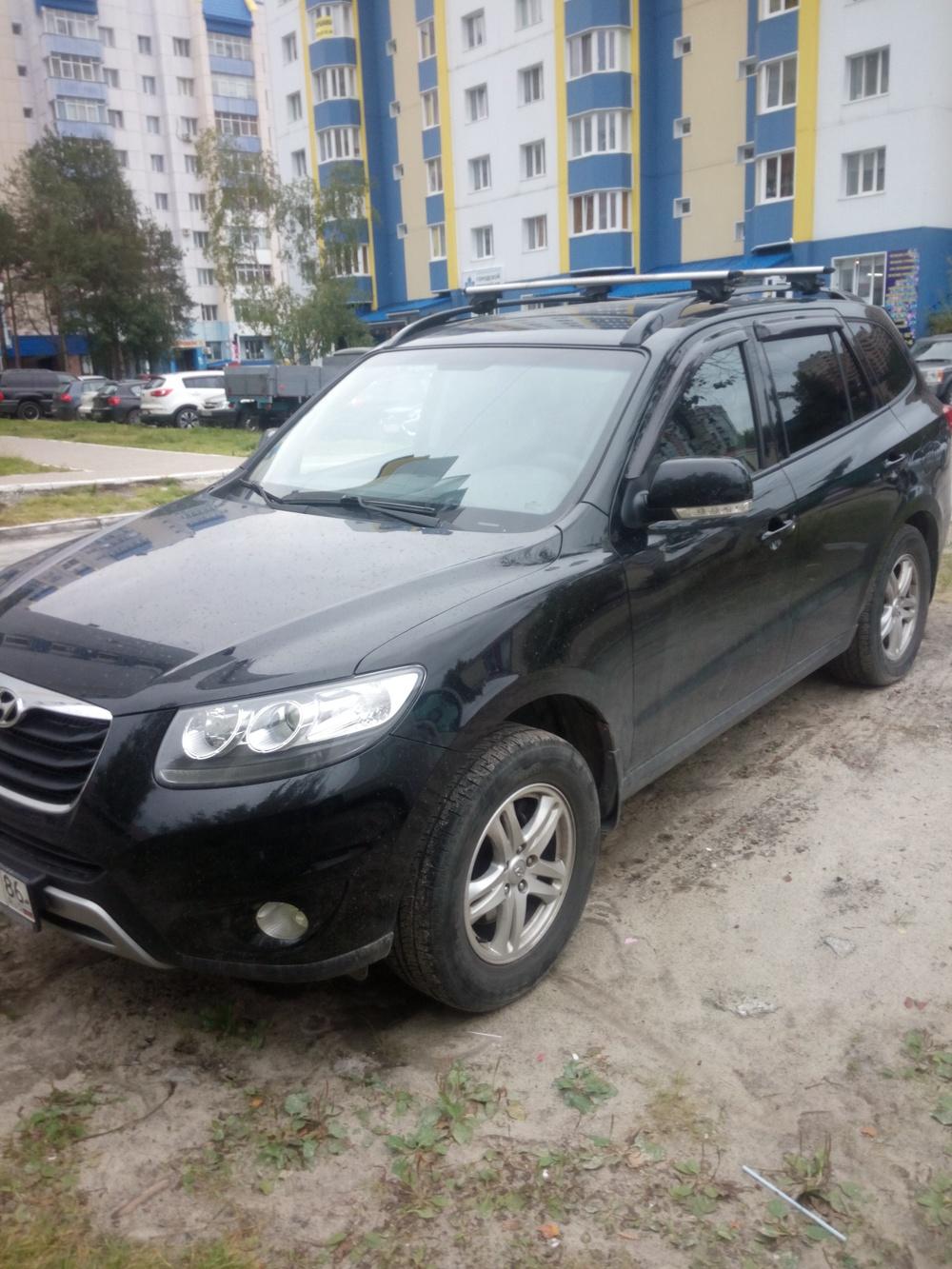 Подержанный Hyundai Santa Fe, отличное состояние, черный , 2012 года выпуска, цена 1 150 000 руб. в ао. Ханты-Мансийском Автономном округе - Югре
