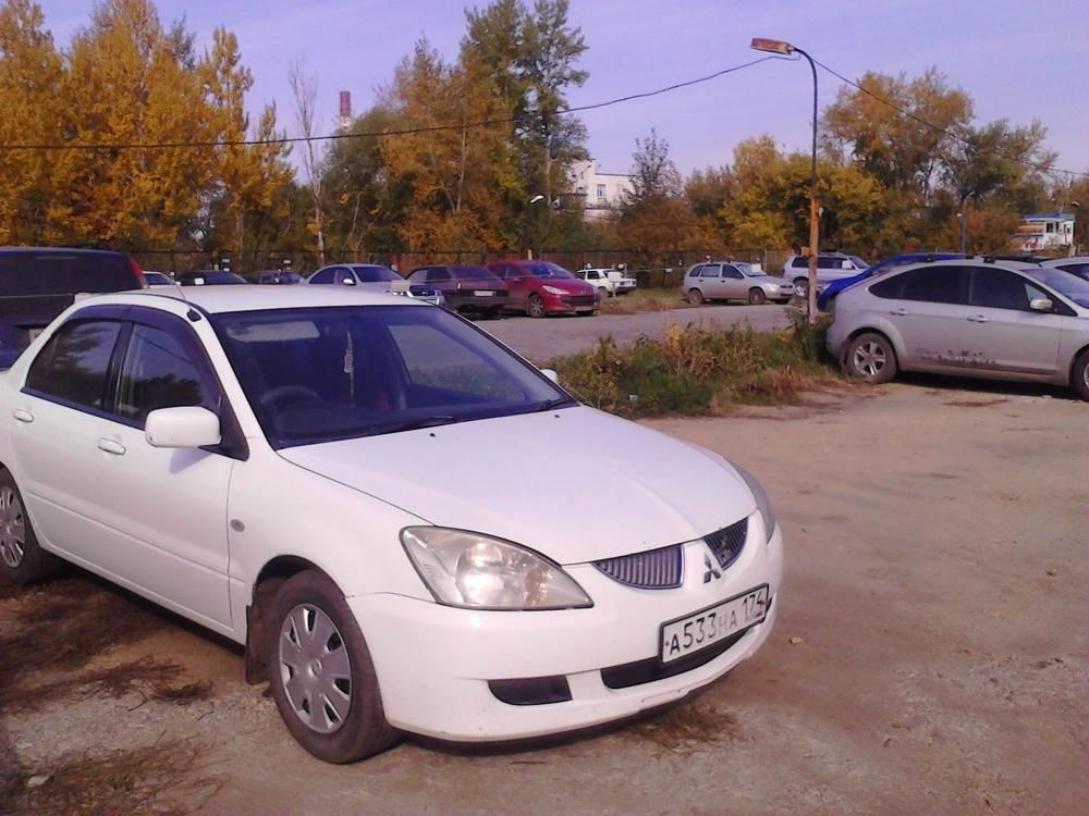 Подержанный Mitsubishi Lancer, хорошее состояние, белый , 2003 года выпуска, цена 215 000 руб. в Челябинской области