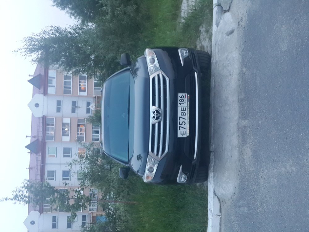Подержанный Toyota Highlander, отличное состояние, черный , 2011 года выпуска, цена 1 500 000 руб. в ао. Ханты-Мансийском Автономном округе - Югре