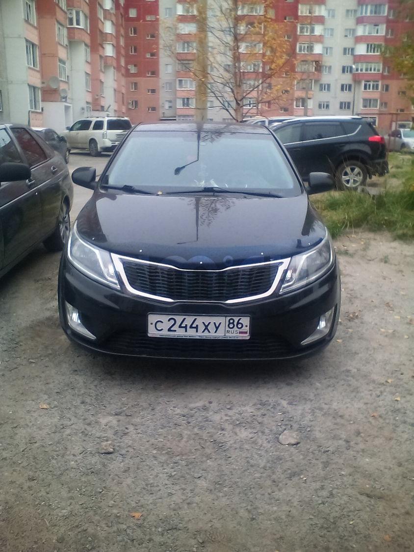 Подержанный Kia Rio, хорошее состояние, черный , 2012 года выпуска, цена 470 000 руб. в ао. Ханты-Мансийском Автономном округе - Югре