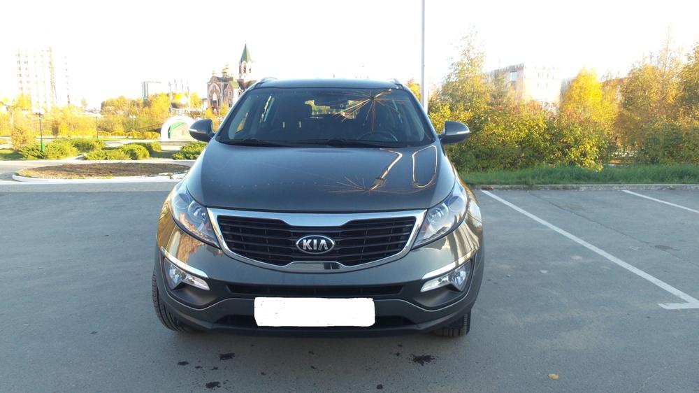 Подержанный Kia Sportage, отличное состояние, серебряный металлик, 2012 года выпуска, цена 850 000 руб. в ао. Ханты-Мансийском Автономном округе - Югре