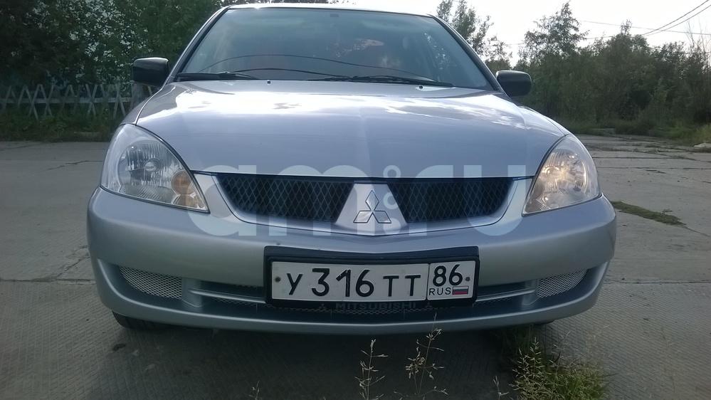 Подержанный Mitsubishi Lancer, хорошее состояние, серебряный , 2009 года выпуска, цена 290 000 руб. в ао. Ханты-Мансийском Автономном округе - Югре