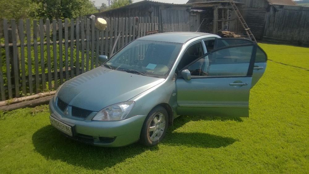 Подержанный Mitsubishi Lancer, хорошее состояние, салатовый , 2005 года выпуска, цена 265 000 руб. в ао. Ханты-Мансийском Автономном округе - Югре