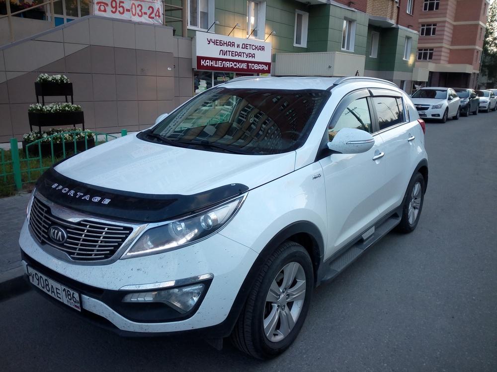 Подержанный Kia Sportage, отличное состояние, белый , 2013 года выпуска, цена 960 000 руб. в ао. Ханты-Мансийском Автономном округе - Югре