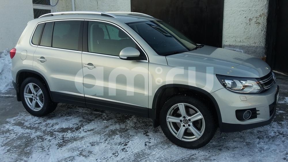 Подержанный Volkswagen Tiguan, отличное состояние, серебряный металлик, 2013 года выпуска, цена 1 350 000 руб. в ао. Ханты-Мансийском Автономном округе - Югре