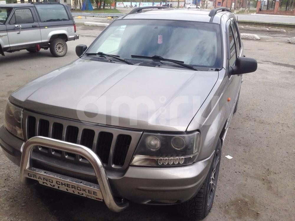 Подержанный Jeep Grand Cherokee, хорошее состояние, коричневый , 1999 года выпуска, цена 450 000 руб. в Тюмени