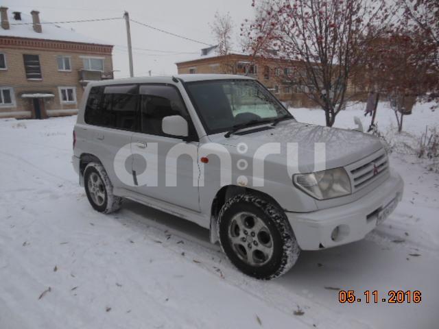 Подержанный Mitsubishi Pajero iO, хорошее состояние, белый , 1999 года выпуска, цена 240 000 руб. в Челябинской области