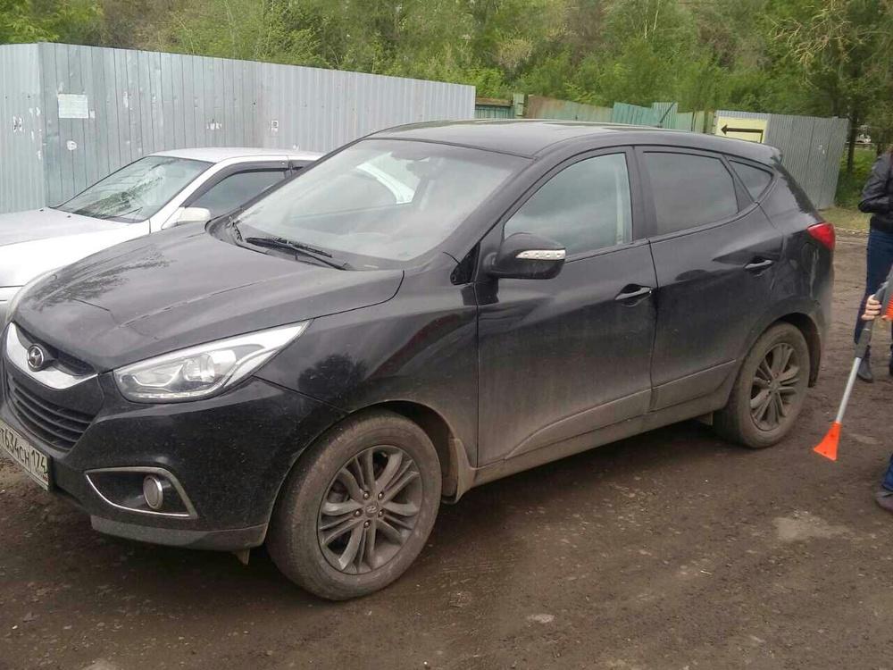 Подержанный Hyundai ix35, хорошее состояние, черный металлик, 2014 года выпуска, цена 950 000 руб. в Челябинской области
