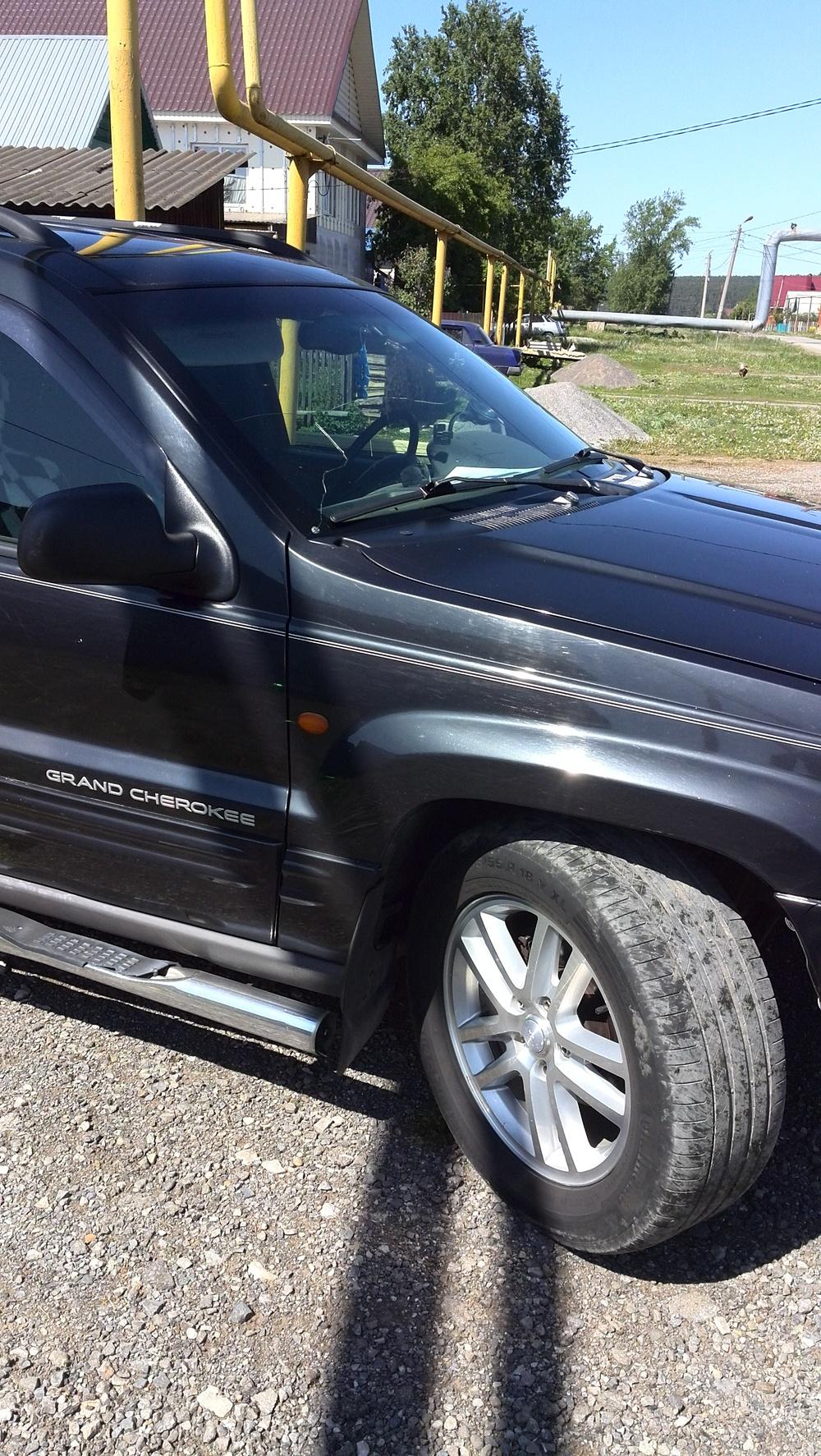 Подержанный Jeep Grand Cherokee, хорошее состояние, черный металлик, 1999 года выпуска, цена 450 000 руб. в Челябинской области