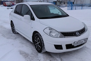 Подержанный автомобиль Nissan Tiida, отличное состояние, 2013 года выпуска, цена 420 000 руб., Сургут