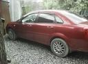 Подержанный Chevrolet Lacetti, бордовый , цена 255 000 руб. в Тюмени, хорошее состояние