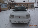 Подержанный Mitsubishi Pajero iO, белый , цена 240 000 руб. в Челябинской области, хорошее состояние