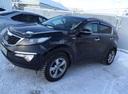 Подержанный Kia Sportage, черный , цена 950 000 руб. в ао. Ханты-Мансийском Автономном округе - Югре, хорошее состояние