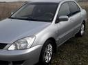 Подержанный Mitsubishi Lancer, серебряный , цена 290 000 руб. в Челябинской области, хорошее состояние