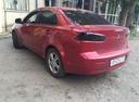 Подержанный Mitsubishi Lancer, красный , цена 365 000 руб. в Челябинской области, хорошее состояние