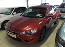 Подержанный Mitsubishi Lancer, красный, 2010 года выпуска, цена 465 000 руб. в Екатеринбурге, автосалон